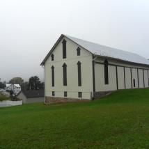 Exterior barn painted by Peachey's Drywall and Painting